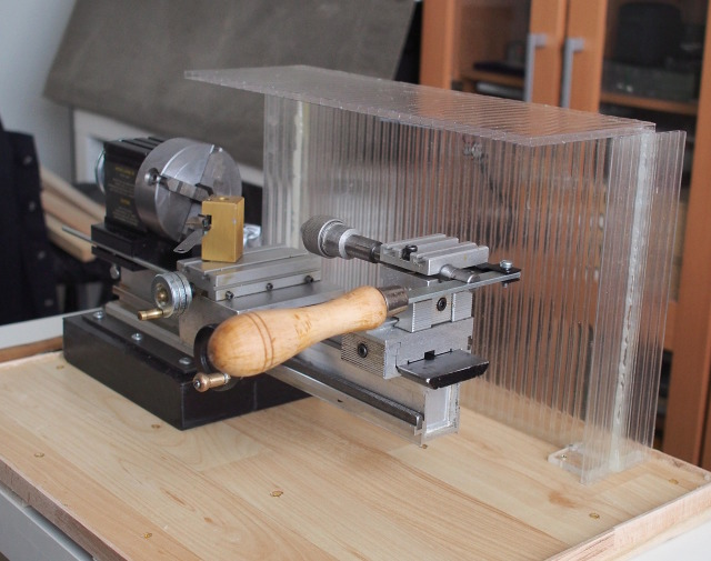 Lathe with back wall and flip top